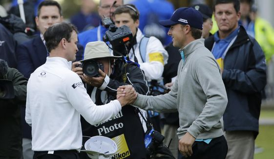 United States' Zach Johnson, left, is congratulated by United States' Jordan Spieth after winning a playoff after the final round of the British Open Golf Championship at the Old Course, St. Andrews, Scotland, Monday, July 20, 2015. (AP Photo/David J.