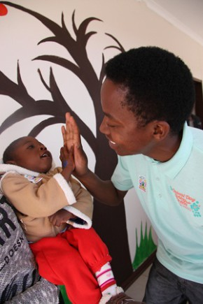 Casual Day ambassador Patrick Mashegwana with Thapelo Phane, from the Rainbow Daycare Centre, on Mandela Day