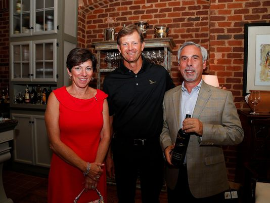 Mike and Susan Belsante pose with Retief Goosen, center, during Goosen's wine launch party at The Grove on June 9.  (Photo: Donn Jones)