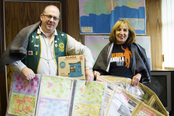 Eden Speaker Doris Nayler (right) and Mr Carl van Blerk from the Eden Lions Club (left), with the items that will be distributed on Mandela Day