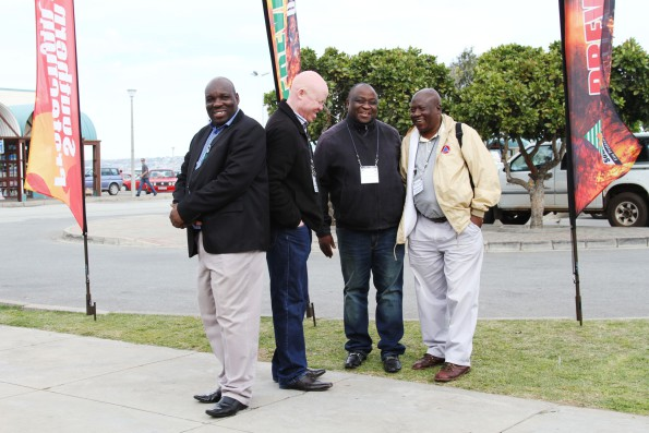 Exploring the exhibitions outside the venue, are (FLTR):  Messrs Donald Makubele, Moshe Manamela and Patrick Lenolani from the Mompani District, as well as, Mr Simon Moroatsshehle from the Greater Letaba Municipality