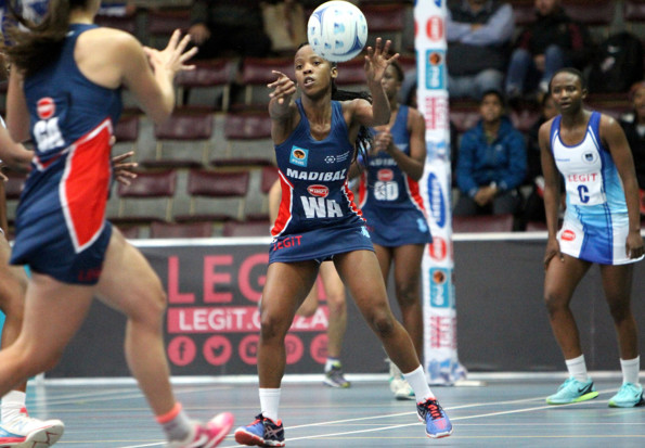 Madibaz wing attack Nandipha Jack passes to NMMU captain Mione Marais during their Varsity Netball clash with UCT in Stellenbosch on Monday evening. Photo: Thys Lombard/Saspa