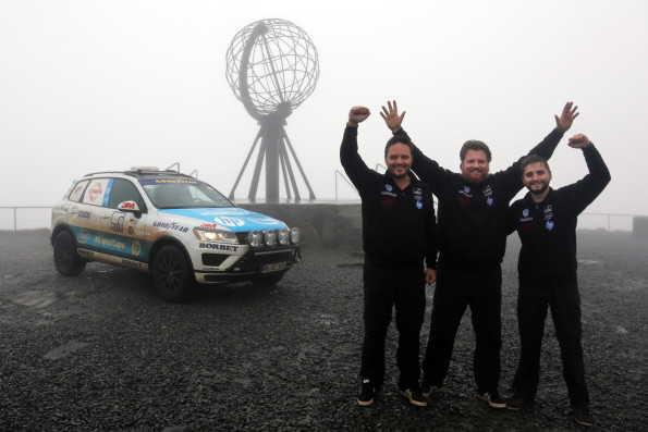 Gruelling trip: seen here are photographer and cameraman Marius Biela, team leader Rainer Zietlow, team leader and Sam Roach, blogger for the record-breaking attempt. In the background is the Touareg. Picture: Quickpic