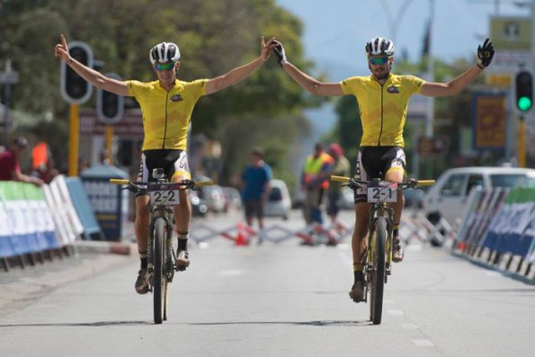 Matthys Beukes (left) and Gert Heyns of SCOTT Factory Racing LCB 1 celebrate their overall victory at the end of Stage 6 of the Cape Pioneer Trek from Calitzdorp to Oudtshoorn, South Africa. Photo credit: Zoon Cronje/Nikon
