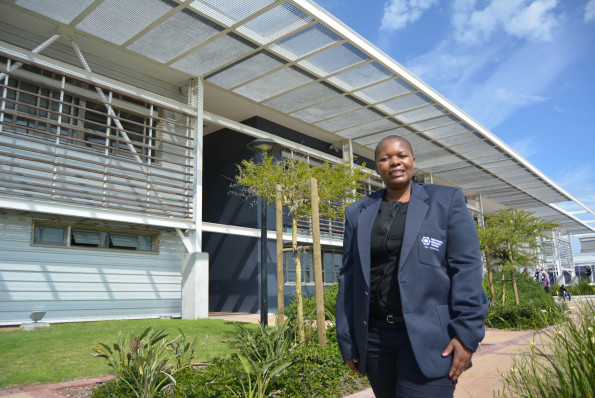 Madibaz director of sport Yoliswa Lumka stands outside NMMU's new High Performance Complex, which was officially launched in Port Elizabeth on Wednesday. Photo: Full Stop Communications
