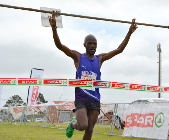 Luthando Hejana celebrates his second straight 10km victory at the SPAR Family Challenge in East London on Saturday. Photo: Full Stop Communications