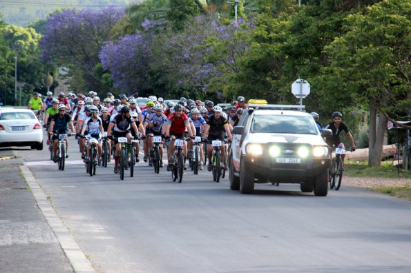 Riders down Swellengrebel Street during the neutral zone start of day 2