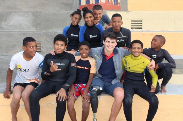Caleb Swanepoel, shark attack survivor with children from the 9Miles project