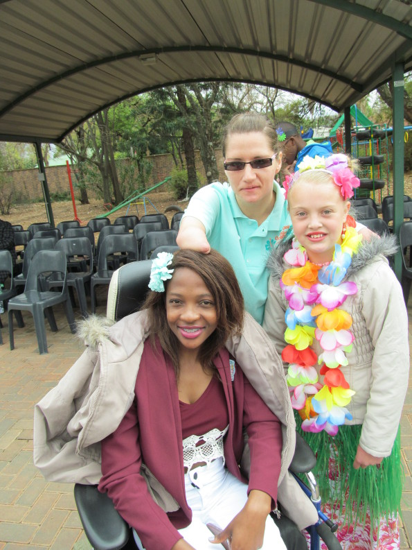 Casual Day ambassadors Benedictor Mokoena (front) and Adri Visser (back) with Alma School learner Angelique Bezuidenhout