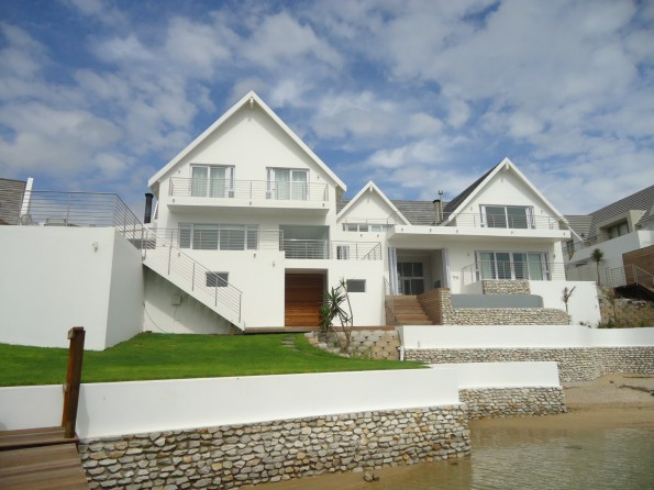 This seven bedroom (all en suite) home on the canals in St Francis Bay has been rented out at R12 150 per day during the forthcoming festive season through Pam Golding Properties. In prime spot overlooking 'Ski Canal' and with river mouth and sea views, this spacious, brand new family home includes eight bathrooms, large open living spaces and entertainment areas, deck with sunken infinity pool, landscaped garden, private beach and jetty