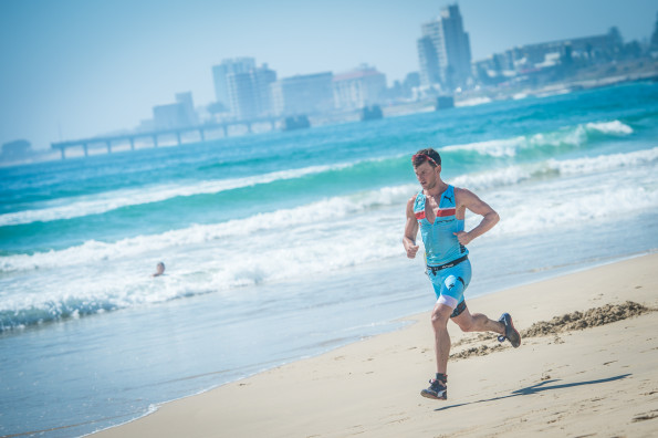 Bradley Weiss claimed victory in the men's race completing the 1.5km ocean swim, 23km mountain bike discipline and 10.2km trail run in a combined time of 02 hours 01 minute 50 seconds.  Photo Credit:  Tobias Ginsberg