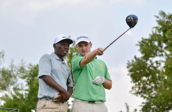 Hume and caddie Joseph Mohulatsi courtesy of Ernest Blignault