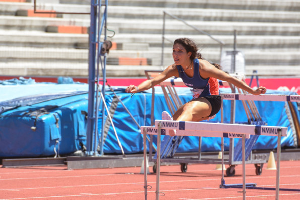 Madibaz hurdler Cayla Seddon in action at the first EP League Track & Field meeting of the season. Photo: Full Stop Communications