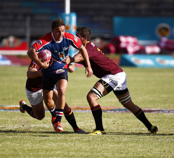 Simon Bolze of Madibaz tries to break a tackle during the FNB Varsity Cup match against Maties. Photo: Saspa