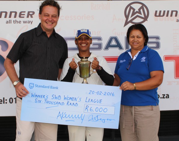 Ms Shireen Noble (Chairperson of the SWD Women's Cricket Association) hands-over the trophy to Haroldine Rhodes (the captain of Union Stars) after the club defeated Mossel Bay by 117 runs in the final on Saturday.  On the left is Albertus Kennedy (CEO of SWD Cricket)