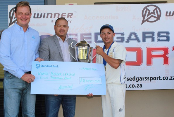 Leroi Bredenkamp (rigth) the captain of Union Stars receives the Petersen Trophy as winners of the Sedgars SWD Premier League from Rudy Claassen (President of SWD Cricket). On the left is Albertus Kennedy (CEO SWD Cricket)