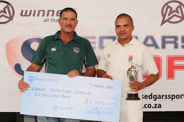 Arthur Lottering, the captain of Ramblers, received the trophy as winners of the SWD Promotion League from Mr Franco Coerecius – a member of the Board of Directors of SWD Cricket