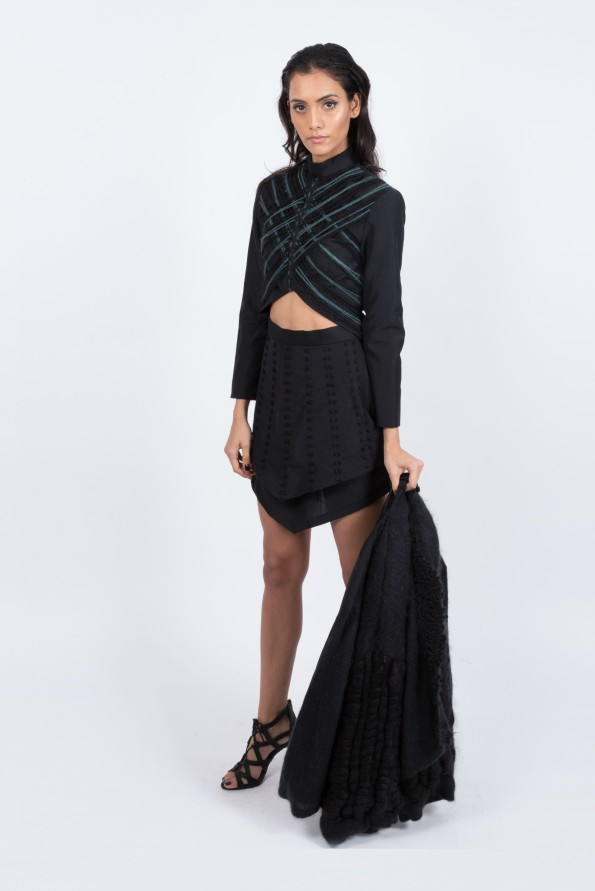 Tayla Shan Nguskos celebrated the feminine form with bare midriffs, plunging necklines and statement embellishments, keeping the focus firmly on hand made textures showcasing the complexity of black
