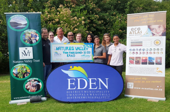 Non-Profit Organisation, Nature's Valley Trust and Eden DM, during the handover of R10 000.00 donation by Eden DM. From left to right are: Mr Mark Brown, Ms Kellyn Whitehead, Mr Vernon Gibbs-Halls, Cllr Mc Combi (Eden DM Portfolio Chairperson: Community Services), Ms Chloe Brooks, Ms Brittany Arendse, Ms Audrey Bonk, Ms Selena Flores and Ms Cindy-Lee Cloete.