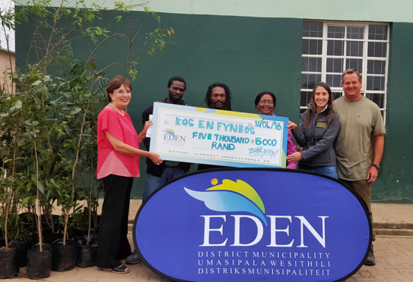 The Kos and Fynbos team with the R5 000.00 cheque donated by Eden DM. From left to right are: Eden DM Speaker, Cllr Doris Nayler, Mr Zamicebo Mgubukeli, Mr Jacob Miller, Ms Eve Stoffels, Ms Monica Vaccaro and Mr Vernon Gibbs-Halls.