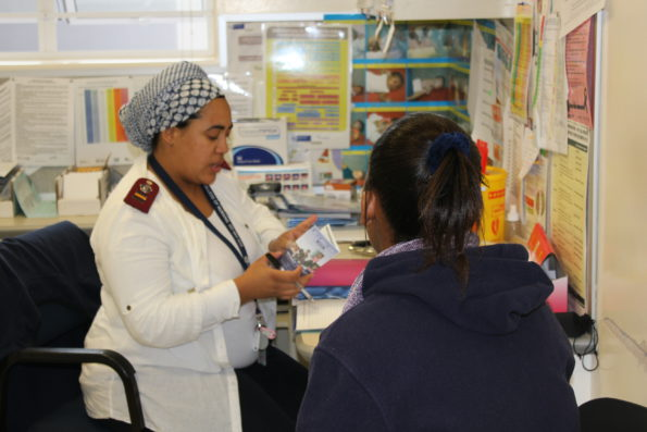 Professional Nurse Zaynab Hendricks in conversation with a teenager regarding her family planning options