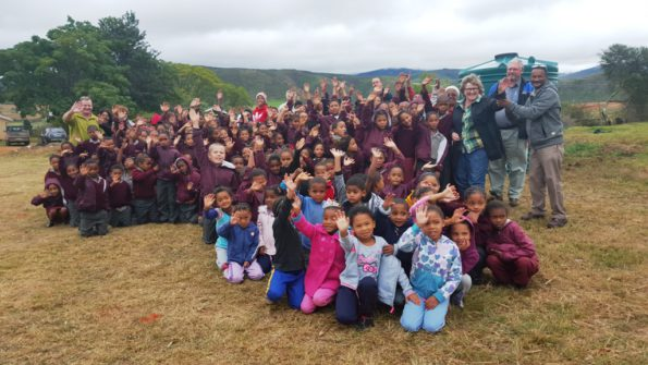 Cheerful learners from Herbertsdale Primary School after a water tank was donated by Eden District Municipality to their school, for their new food garden