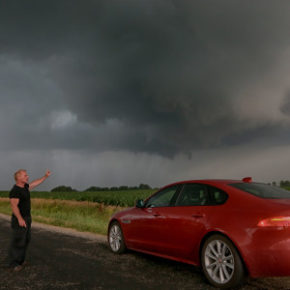 Tornado Tim drives a country road in search of an oncoming Tornado outside of Princeton Illinois on Wednesday June 22, 2016 (photo by Sandy Huffaker/Jaguar)