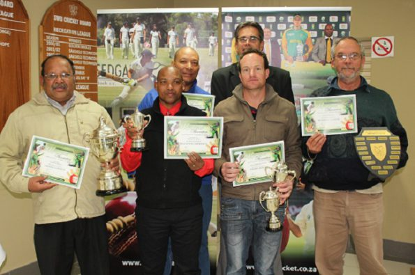 Moses Carolus (Winner:  Premier League), Brendon Lawrence (Runner-Up Reserve League), André Olivier (Winner:  Reserve League) and Wilhelm Sander (Administrator of the Year).  In the back row are Hennie Pieterse (Keenest Umpire) and Jean Neethling