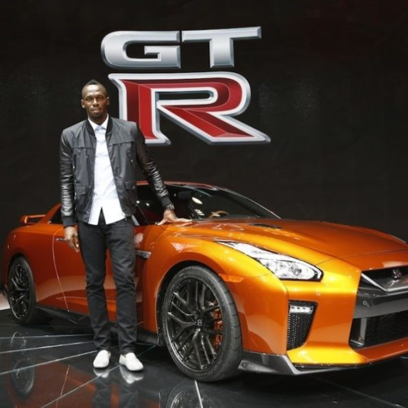 Usain Bolt with his custom Nissan GTR. Picture: Motorpress
