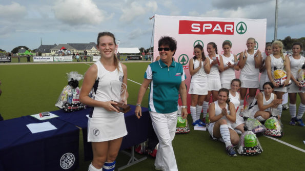 Collegiate captain Harriet Bisdee receives the trophy in the PE Coastal tournament from national director Les Galloway. Photo: Full Stop Communications