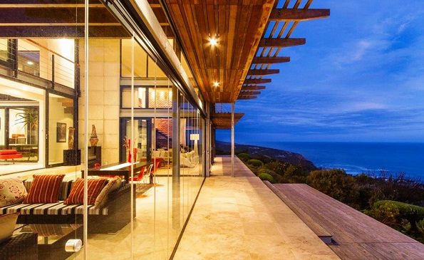 """ULTRA LUXURY: This five bedroom, five bathroom secure estate home in Knysna boasts a state-of-the-art gourmet kitchen, a """"gyro-focus"""" rotating fireplace, underfloor heating and a glass-fronted swimming pool, as well as spectacular ocean views. It is on the market for R19.74 million"""