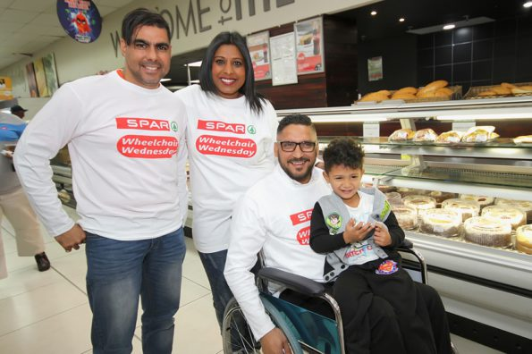 At the launch of the SPAR Wheelchair Wednesday campaign were, from left, AlgoaFM deejay Charlton Tobias, SPAR Eastern Cape sponsorship controller Roseann Shadrach, SUPERSPAR Gelvandale general manager Yusuf Gelderbloem (in the chair) and his son Aneeq. Photo: Leon Hugo