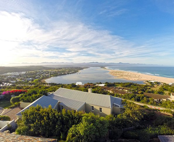 QUINTESSENTIAL COASTAL LIVING: This luxurious four bedroom family home in the wealthy playground of Plettenberg Bay on the Garden Route is beautifully finished with an open-plan living area and floor-to-ceiling windows to optimise natural light. On the market for R11.5 million, it boasts panoramic views of the Tsitsikamma mountains, ocean and lagoon