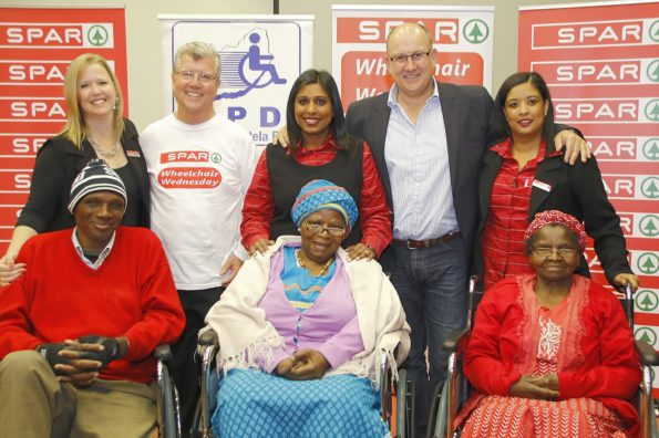At the SPAR Wheelchair Wednesday handover ceremony at the Nelson Mandela Bay Stadium today were (back, from left) SPAR EC promotions and advertising manager Wendy Westraadt, APD executive director Brian Bezuidenhout, SPAR promotions and advertising controller Roseann Shadrach, executive mayor Athol Trollip, SPAR promotions and advertising assistant Debadene Baatjies, and (front, from left) wheelchair recipients Vuyisile Maewe, JK Mbola and Nombulelo Ntingila. Photo: Leon Hugo