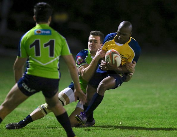 Harlequins captain Nathie Botha tackles Lindo Shusha of Pointers in the Steinhoff NMMU Koshuis league final at the South Campus. Photo: Richard Huggard