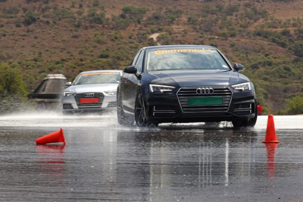 Two identical vehicles demonstrate handling on a wet skidpan at the Gerotek Test Facilities during the Automobile Association's (AA) car tyre safety demonstration. The car at the back (red number plate) has worn tyres, the car in front (green number plate) has brand new tyres.Picture: Inga Terblanche