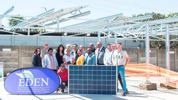 During the launch of the PV Plant, were (back row, from left to right): Electrical Engineer, Mr Dave Gyndell, Eden DM's Manager: Bulk Infrastructure, Mr Faan Van der Merwe, Portfolio Chairperson: Roads, Cllr Tertuis Simmers, Superintendent: Property Development & Maintenance, Mr Mario Appels, and Portfolio Chairperson: Corporate Services, Cllr Isaya Stimela. Front row (from left to right) are: Eden DM's Chief Financial Officer, Ms Louise Hoek, Executive Deputy Mayor, Cllr Rosina Ruiters, Executive Manager: Corporate-/Strategic Services, Ms Trix Holtzhausen, Portfolio Chairperson: Rural Development, Cllr Joslyn Johnson, Portfolio Chairperson: Strategic Services, Cllr Erica Meyer, Portfolio Chairperson: Community Services, Cllr Khayalethu Lose, Executive Manager: Community Services, Mr Clive Africa, Mr André Anderson from Engeryneering, as well as Messrs Alex van der Westhuizen and Jandrey Glaeser from Trackos Projects, with (front, sitting) Eden DM's, Handyman: Maintenance, Mr Wayne Cronjé.