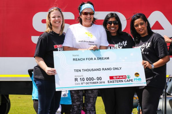 SPAR Eastern Cape promotions and advertising manager Wendy Westraadt (left) hands over a cheque of R10 000 to Reach for a Dream Eastern Cape branch manager Ronell Davel at the SPAR Family Challenge in East London. With them are SPAR promotions and advertising controller Roseann Shadrach (second from right) and promotions and advertising assistant Debadene Baatjies (extreme right). Photo: Dean Venish