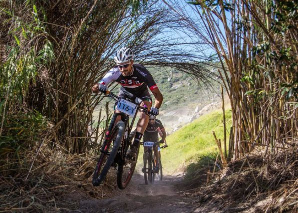 ASG's Pieter Seyffert leads team-mate Hanco Kachelhoffer through a section of single-track on the final stage of the Sanlam MTB Invitational near Paarl today. Photo: Warren Elsom/Capcha