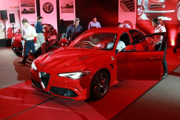Admiration: guests examine the new Alfa Romeo Giulia in Sandton. Picture: Quickpic