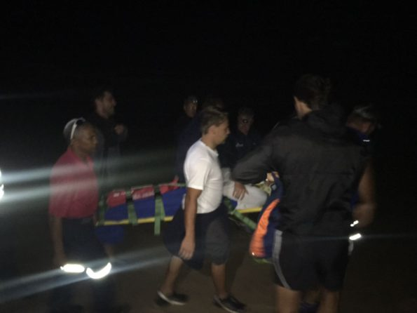 Photographs by NSRI Plettenberg Bay shows 16 year old Arnold Nel being carried by rescuers