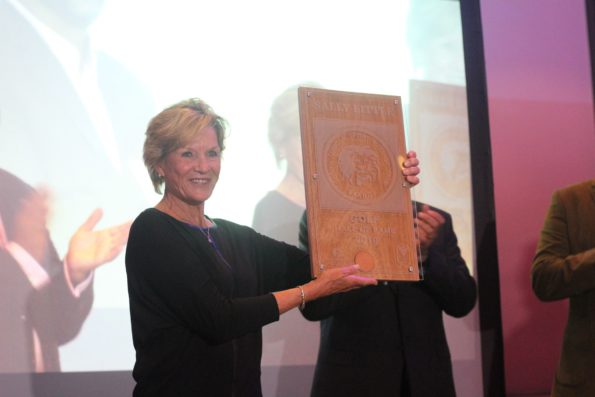 Sally Little holding her SA Hall of Fame plaque; credit Unipro Media / PinkStig
