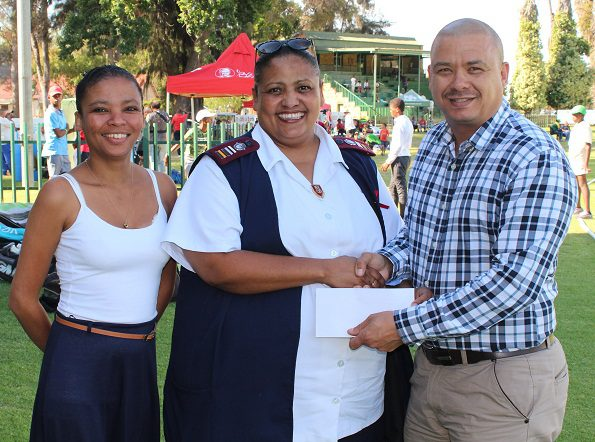 Sr Christelle Pekeur (centre) received the gift form Mr Rudy Claassen (President SWD Cricket).  On the left is Ms Zenobia Nel, the Human Resource Administrator of SWD Cricket, who organized the event