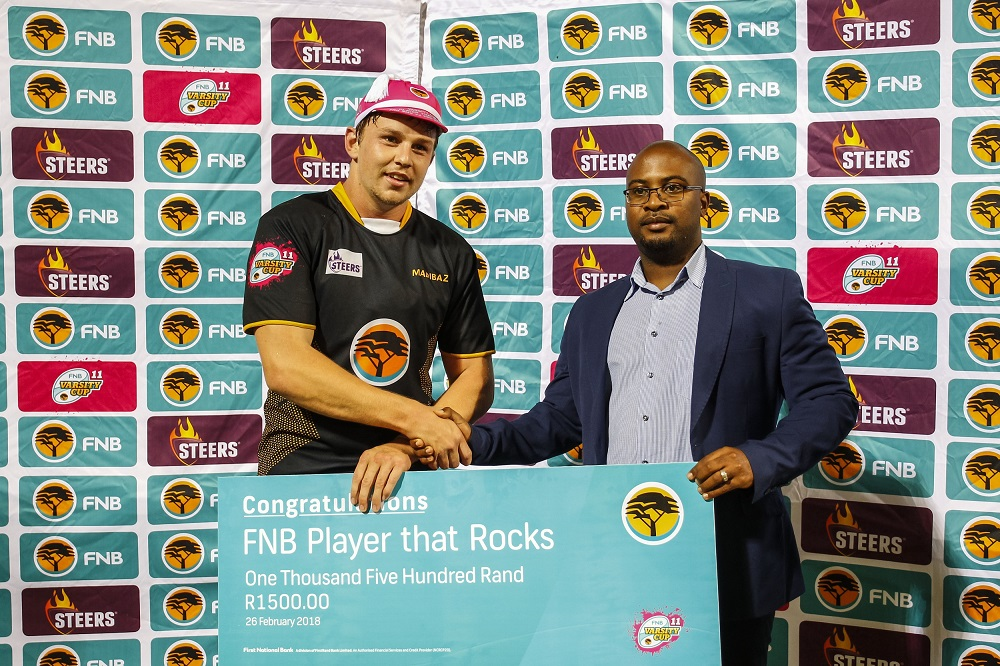 FNB Madibaz flank Brandon Brown receives the Player that Rocks award from FNB's Amandla Ndongeni following their match against NWU-Pukke at Madibaz Stadium in Port Elizabeth. Photo: Asem Engage